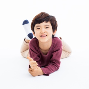 Young Asian boy showing thumb